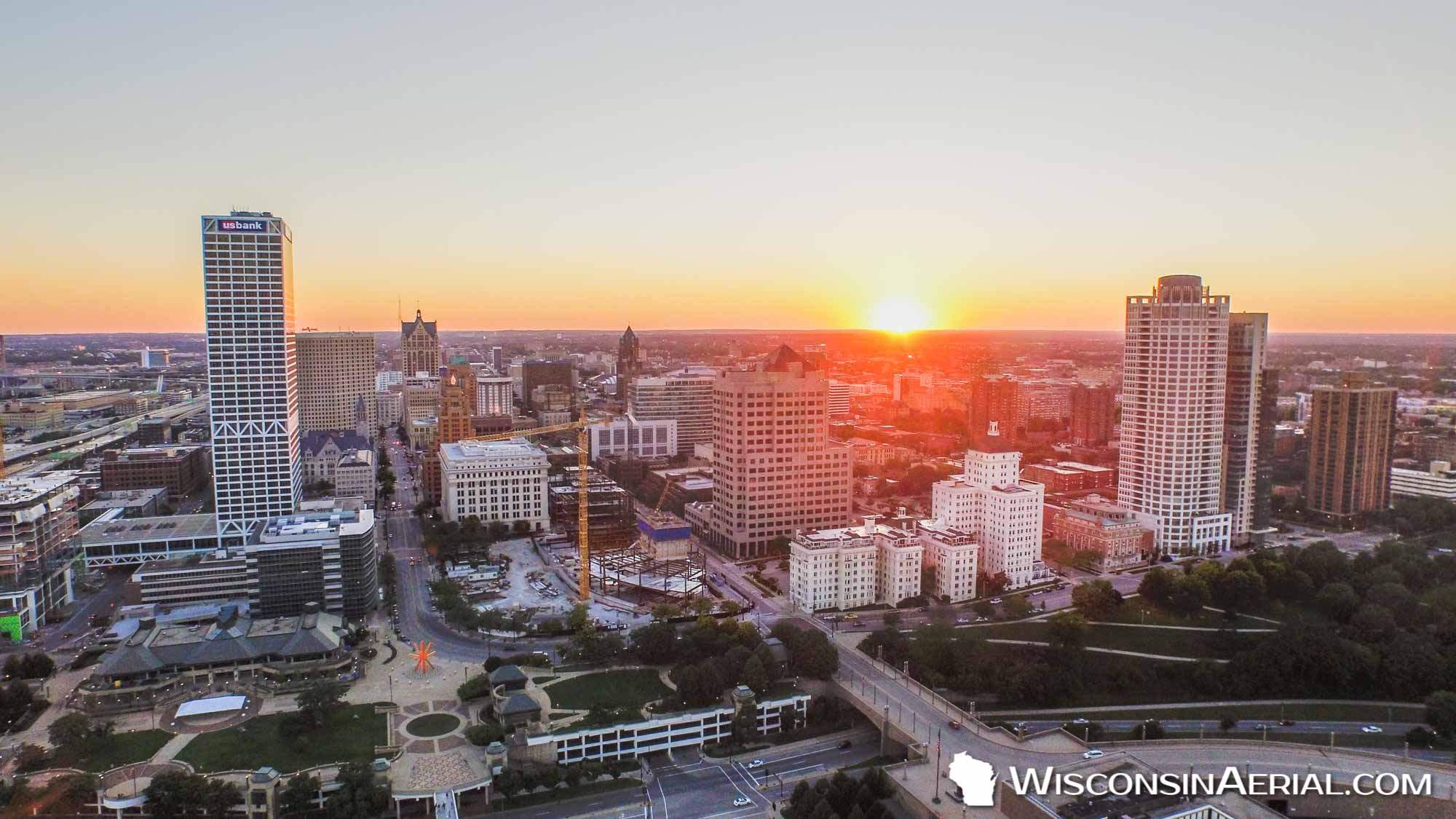 sunset behind milwaukee skyline wisconsin aerial media